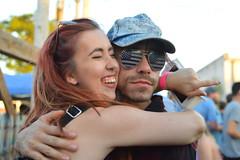Hugs in America (radargeek) Tags: oklahoma sunglasses hug flag norman american 2016 nmf normanmusicfestival walkbyportrait