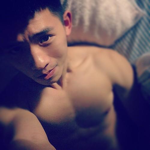 Asian Guy In Bed