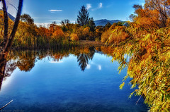 A Peace of Autumn :) (Kevin_Jeffries) Tags: blue autumn light cloud mountain color colour reflection tree nature beauty leaves reeds landscape interesting pond nikon flickr day bright natur peaceful naturallight hills clear idyllic stillness flax foothill d90 kevinjeffries