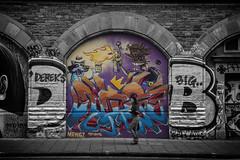 Arch graffiti (Daz Smith) Tags: city uk portrait people urban blackandwhite bw woman streets art blancoynegro monochrome wall canon bristol walking graffiti blackwhite bath mural paint candid graf citylife thecity streetphotography spray canon6d dazsmith bathstreetphotography