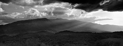 Piercing light (ChrisBrn) Tags: light panorama sun mountain clouds landscape shadows rays sunrays