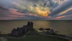 Sunset blast over Dunure Castle (David Alexander Elder) Tags: uk sunset castle sunrise landscape scotland clyde landscapes ancient scottish sunsets escocia aerial brave mystical schottland schotland ecosse dunure drone scozia skotlanti skotland dji   skotsko  kotska kotija eskosya