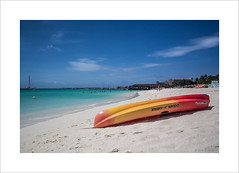 A peach of a beach (andyrousephotography) Tags: blue sea sun holiday beach relax boats hotel coast kayak sailing turquoise venezuela aruba drinks watersports cocktails palmbeach riupalace dutchcaribbean