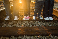 The Murphy Family (JeffHallPhotos) Tags: railroad family sun sunlight london smile portraits square jack oakland kid child bokeh mother tracks converse flare 135mm 200mm