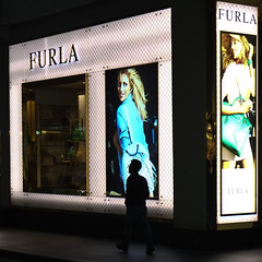 Furla (Leon Sammartino) Tags: street man window shop lady night advertising melbourne x illuminated billboard blond series fujifilm photogrpahy furla xe1 fujifilmxe1rainmelbournesunday