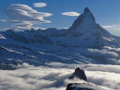 Matterhorn and Riffelhorn piercing the clouds (lvalgaerts) Tags: snow clouds switzerland spring rosa glacier gornergrat zermatt matterhorn monte gletscher lenticular dufour cervino gorner riffelhorn