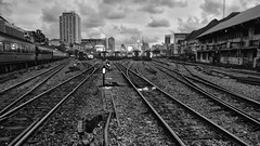 Railroad tracks (akimesto) Tags: road old city railroad travel sky urban blackandwhite white black building abandoned monochrome field lines sport skyline architecture night clouds zeiss train dark thailand track cityscape outdoor decay bangkok sony tracks landmark structure architect trail exotic infrastructure vehicle hua exploration depth a7 cloudscape skycraper lamphong pesport