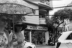 Hanoi Street Reality (Pexpix) Tags: 400tx bw blackandwhite digitizedfilmnegative film kodakd76 kodaktrix400 leica35mmsummicronmf2asph leicampsilver monochrome hanoi hni vietnam