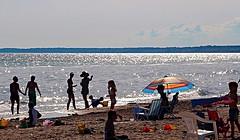 Celebrating a Day at a Time (Haytham M.) Tags: ocean sea summer sun lake reflection beach swimming umbrella fun sand outdoor shore canont4i