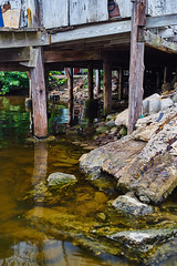 Truss (FunkadelicSam) Tags: ocean old city sunset people urban lake reflection beach water rotting portraits pond rocks downtown florida grunge boulder ft decaying myers truss