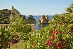 Tonnara di Scopello (moniq84) Tags: sea summer sky italy verde green fleurs mare estate blu bleu cielo sicily fiori piante sicilia trapani faraglioni sicile scopello tonnara