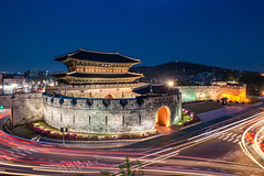 Hwaseong Fortress (Joshua Davenport) Tags: travel motion heritage architecture movement ancient gate asia arch traffic landmark korea unescoworldheritagesite unesco motionblur seoul citylights pavilion nightscene fortification southkorea protection fortress defense hwaseong suwon blurredmotion fortresswall ancientbuilding koreanculture fortressgate hwaseongfortress janganmun koreanarchitecture trafficblur blurredtaillights travelbackground seoullandmark janganmungate