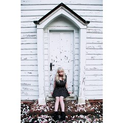 Chipped paint & flower petals (Porcelain Veins) Tags: old flowers house building church girl fashion spring peeling paint boots polkadots blonde chipped emotive flowerspetals abdoned