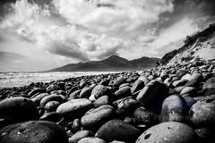 Across the stones (Z0L1TA) Tags: beach skyline clouds shoreline northernireland nationaltrust allrightsreserved mournemountains norniron murloughnaturereserve zolitamykytyn zolitaphotography nousewithoutpriorwrittenconsent