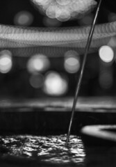 Delicious bokeh (PeterThoeny) Tags: california blackandwhite abstract blur art water fountain monochrome night lights raw bokeh jet sanjose indoor depthoffield santanarow shallow splash hdr  shallowdepthoffield watersplash waterjet photomatix fav100 1xp fountainjet nex6 sel50f18