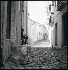 Mouraria (ogisa car) Tags: street blackandwhite 6x6 lisboa cobblestone ilforddelta400 yashicamat124g mouraria yashinon75mmf35
