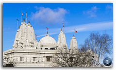 Hindu temple BAPS Shri Swaminarayan Mandir in London, United Kingdom (KS Photography!) Tags: uk sculpture india color building london art history statue stone architecture clouds landscape religious temple hope exterior image god unitedkingdom britain indian traditional religion praying culture style monk bluesky landmark palace structure east dome brent marble spirituality shiva hindu hinduism tranquil mandir baps ethnicity contemplation pandit shri swaminarayan neasden lordkrishna