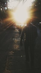 He walked right into the light. (aditi narain) Tags: street boy portrait sunlight guy silhouette warm walk sunrays checked warmtones