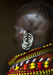 Turkana Tribe Woman With Huge Necklaces And Earrings, Turkana Lake, Loiyangalani, Kenya (Eric Lafforgue) Tags: africa portrait people woman beauty fashion vertical closeup photography necklace women day adult kenya decoration earring multicoloured tribal headshot piercing jewellery ornament bead tribe adultsonly oneperson ornement kenyan eastafrica rift braidedhair traditionalclothing realpeople turkana colorimage darkbackground onewomanonly ruralscene personalaccessory oneyoungwomanonly nonurbanscene colourimage 1people indigenousculture neckring loiyangalani onlywomen turkanalake nomadicpeople northkenya colourpicture ethnicjewel onewomanonlywoman kenya201401075