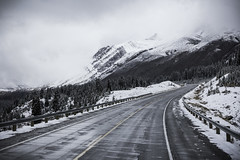 Along the Icefields Parkway... [explored] (Bluesilver85) Tags: road park travel sky white mountain snow canada mountains nature clouds landscape rockies landscapes driving canadian explore national alberta banff snowing montagna ontheroad paesaggio