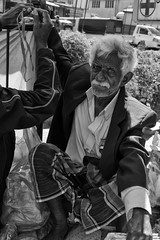 the man with white hair (Claudia Merighi) Tags: street people blackandwhite blancoynegro monochrome face look expression streetphotography streetportrait monochromatic moustache streetphoto pretoebranco sarong streetmarket k3 whitehair blackandwhitephotos monocromatico streetphotographers blackwhitephotos fotografiacallejera worldface strassenfotografie blackandwhiteonly fotografiadistrada pentaxk3 ricohimages lamerighi claudiamerighi bnbwbwbiancoenero fotografiederue