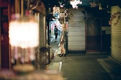 Omoide yokocho (vixalice) Tags: film girl japan night 35mm asian 50mm lights tokyo evening lomography model nikon shinjuku kodak 35 portra f4 authentic yokocho nikonf4 filmphotography portra400 omoideyokocho film35