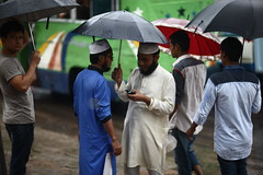 A rainy day conversation (N A Y E E M) Tags: men moulana pedestrians umbrella rain monsoon afternoon candid street dampara cdaavenue chittagong bangladesh sooc raw unedited untouched unposed conversation explored