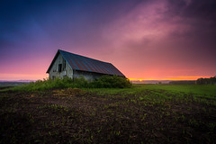 The Old Barn II (Arvid Bjrkqvist) Tags: old sunset sun house storm colors field grass rain clouds barn sweden horizon perspective vivid overcast dirt vrgrda