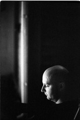 SeanDevonMikey6.16.16_045 (Johnny Martyr) Tags: line man light dark composition darkness 6400iso nikon nikkor f2sb ilford delta ilforddelta grain grainy availablelight existinglight dimlight noflash photojournalism shavedhead bald head smooth circular bw blackandwhitefilm 35mm nikkor50mm14sc 50mm night thought concentration thinking contemplation contemplate thoughtful concentrate excessive headroom contrast shadows face portrait mystery mysterious deep profound