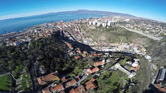 Rijeka from the sky (Tomislav C.) Tags: city sea urban panorama sun mountain mountains bird tourism nature beauty buildings landscape flying gulf aircraft air flight perspective croatia aerial cranes roofs shooting exploration ports adriatic rijeka urbex drones unmanned drone highseas gopro quadcopter kvarnerbay primorskogoranskažupanija hero4black