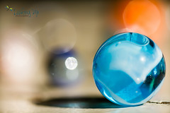 Lost - Greenwich Fine Art Photography (LookingUpPhotography) Tags: blue lost bokeh fineart marbles marble fineartphotography lostmymarbles karenkahn lookingupphotography greenwichphotographer lookingupphoto greenwichfineartphotographer greenwichfineartphotography