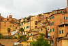 Senese Urbanscape (sweeneybrandon) Tags: travel trees houses summer sky italy orange brick green tourism yellow architecture buildings europe italia rooftops overcast naturallight it case tuscany shutters balconies siena toscana tu urbanscape