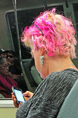 Pink hair, earrings, and cell phone San Francisco BART Train 150506-125334 C4 (Wambeke & Wambeke Photography, Art, & Textiles) Tags: pinkhair womanwithpinkhair cellphone publictransportation bart charliewambekephotography wambekewambeke canonpowershotsx50photograph