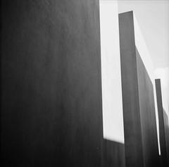 Monumental Darkness (©skarson) Tags: light blackandwhite bw white black berlin 120 film analog zeiss germany europe jewish ikon ilford fp4 canoscan ilfordfp4plus zeissikonnettar nettar denkmalfürdieermordetenjudeneuropas 9000f canoncanoscan9000f