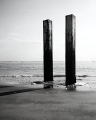 Vlissingen (milov) Tags: shadow sea bw sculpture art beach metal phonecam waves horizon artsy tall pillars vlissingen motox tweetme fbme instagram