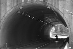 Lone rider (Elios.k) Tags: road camera travel november light shadow vacation people blackandwhite bw travelling monochrome bike silhouette japan horizontal forest canon dark concrete outdoors person photography japanese one asia alone crossing empty perspective tunnel motorbike valley lane headlight headlamp rider naganoprefecture chubu 2015 honsu japanalps centralalps kisohighway drivingleft hidamountains mizuya chbu 5dmkii kisodistrict nationalroute361