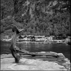 Anchor in Geiranger (BG Sixtyniner) Tags: sea bw 120 6x6 film norway analog mediumformat square blackwhite spring harbour hasselblad anchor roll fjord delta100 scandinavia ilford f28 geiranger planar 80mm 500cm carlzeiss homedev patersontank