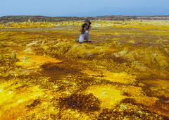 Tourist taking picture of the colorful volcanic landscape of dallol in the danakil depression, Afar region, Dallol, Ethiopia (Eric Lafforgue) Tags: africa travel woman lake color tourism nature pool beauty horizontal landscape outdoors volcano spring women colorful solitude day desert natural earth acid horizon surreal tourist formation serenity heat minerals environment sulphur isolation geography geology ethiopia hotspring volcanic saline geothermal interest arid ecosystem hornofafrica afar eastafrica geological abyssinia onewomanonly fulllenght 1people afarregion dallol danakildepression ethio161915