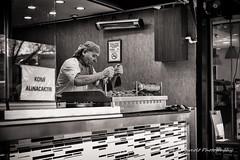 Street 124 (`ARroWCoLT) Tags: street people bw food man monochrome sepia photography blackwhite candid fastfood fast samsung istanbul f2 dner kebab seller sb doner sokak kokorec 30mm nx skdar siyahbeyaz komi kokore nx300