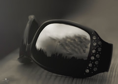clouds in my eyes (rockinmonique) Tags: blackandwhite bw storm monochrome sunglasses clouds canon reflections dark mono ominous stormy tamron 52in52 moniquew