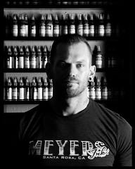 Meyers Ink.. (soul pixie) Tags: blackandwhite man tattoo contrast canon beard artist skin piercing stare stark permanent inks alienbees tattooartist kearstenlederphotography meyersink