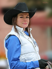 A Mona Lisa Smile (wyojones) Tags: woman cute girl beautiful smile hat hair pretty texas houston parade glove vest cowgirl brunette lovely blueshirt houstonlivestockshowandrodeo reins cowgirlhat hatband trailrider wyojones houstonlivestockshowandrodeoparade