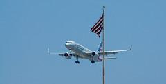 Incoming (Black Hound) Tags: fortmifflin sony a500 minolta airplane flag