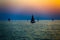 sailing at sunset - Tel-Aviv beach (Lior. L) Tags: travel sunset sky beach nature telaviv sailing silhouettes serenity sailboats travelinisrael sailingatsunsettelavivbeach