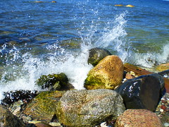 Spray at Visby beach (Pl Bmgarr) Tags: light sea sunlight water rock waves sweden pray gotland visby