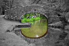 Through A Bridge Brightly (JDWCurtis) Tags: people reflection nature water southwales wales reflections blackwhite nationalpark breconbeacons brecon waterway powys naturalframe selectivecolouring breconandmonmouthshirecanal breconbeaconsnationalpark peopleinnature