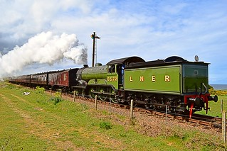 B12 Steam Loco and its train approach Sheringham along the Poppy Line,  on a sunny & blustery afternoon. North Norfolk Railway. 02 05 2015