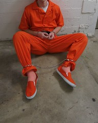 IMG_0073crop (bob.laly) Tags: uniform jail shackles handcuffs prisoner jumpsuit inmate