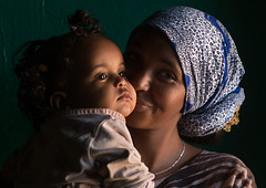 Sufi mother kissing her baby, Harari region, Harar, Ethiopia (Eric Lafforgue) Tags: africa travel portrait people woman baby color childhood horizontal female scarf outdoors women toddler kissing child adult african muslim islam religion headscarf mother lifestyle indoor unescoworldheritagesite indoors shawl ethiopia sufi sufism 2people twopeople carrying hornofafrica ethiopian eastafrica thiopien harar etiopia abyssinia ethiopie etiopa harari  etiopija ethiopi  africanculture etiopien etipia  etiyopya     harariregion      ethio162907