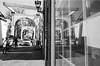 Mirrored cyclists @ Breukelen (PaulHoo) Tags: city people urban blackandwhite bw holland reflection film window monochrome analog 35mm mirror nikon cyclist citylife f5 breukelen lightroom 2016 adox silvermax